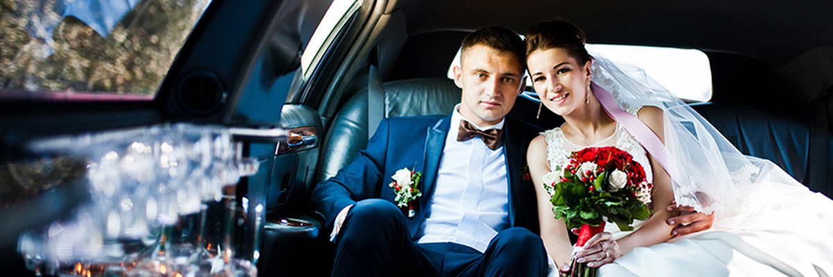 Wedding Couple in the Back of a Limousine